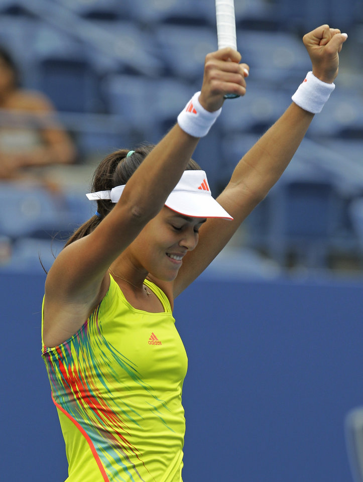 Photo -   Serbia's Ana Ivanovic reacts after winning her match against Bulgaria's Tsvetana Pironkova in the fourth round of play at the 2012 US Open tennis tournament, Monday, Sept. 3, 2012, in New York. (AP Photo/Kathy Willens)