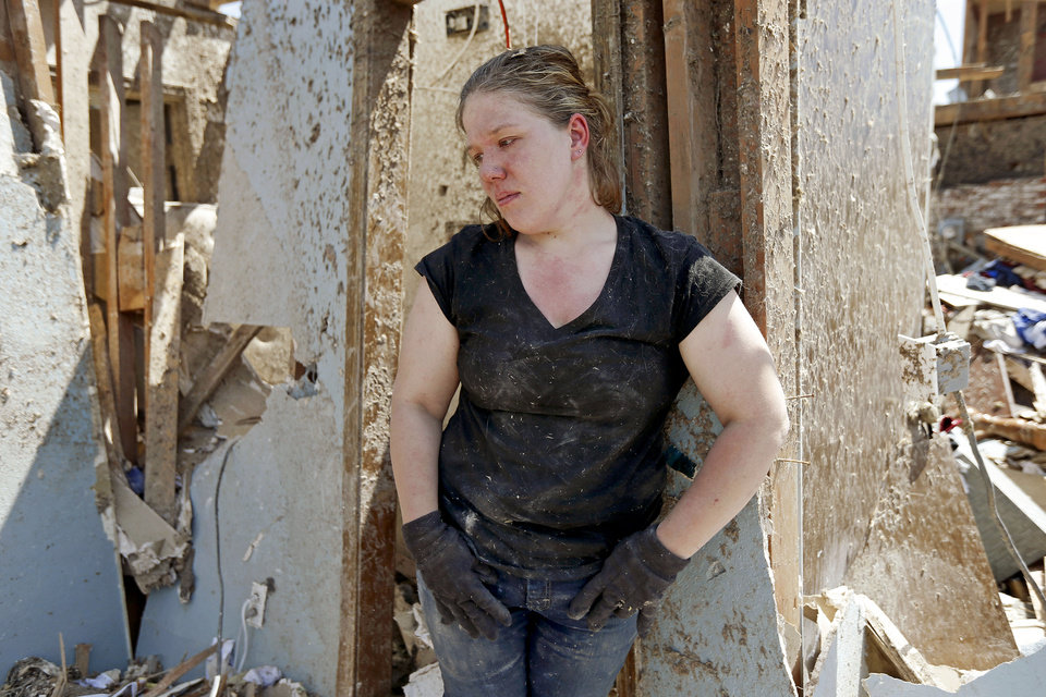 Sarah Patteson stands by the spot where she and her two children took shelter as the tornado hit their house on Kings Manor in Moore, Okla., on Wednesday, May 22, 2013. A tornado damaged the area on Monday, May 20, 2013. Photo by Bryan Terry, The Oklahoman