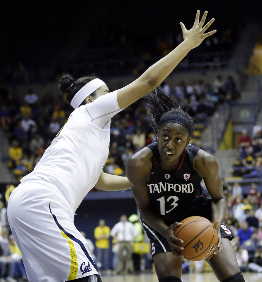 Photo - Stanford forward Chiney Ogwumike (13) tries to get around California forward Justine Hartman during the first half on an NCAA college basketball game, Sunday, Feb. 2, 2014, in Berkeley, Calif. (AP Photo/Marcio Jose Sanchez)