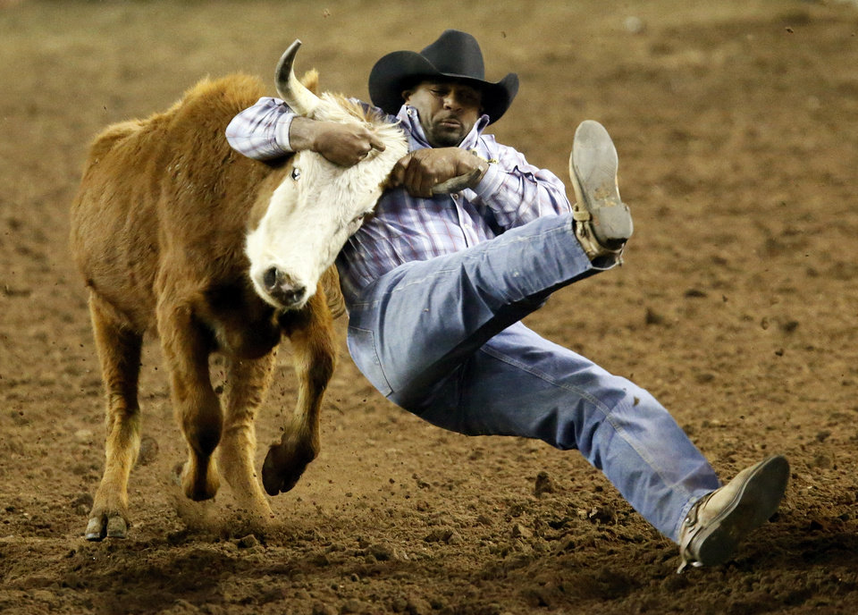 Photo - Ronnie Fields of Oklahoma City competes in steer wrestling during the International Finals Rodeo (IFR 44) at the Jim Norick Arena at State Fair Park in Oklahoma City, Sunday, Jan. 19, 2014. Photo by Nate Billings, The Oklahoman
