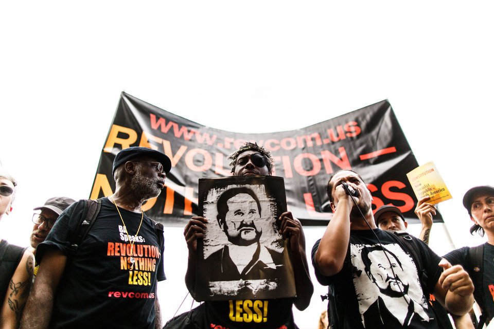 Photo - Members of the Revolutionary Communist Party protest outside one of the entrances to the Wells Fargo center Monday, July 25, 2016, in Philadelphia, during the first day of the Democratic National Convention. (James Robinson/PennLive.com via AP)