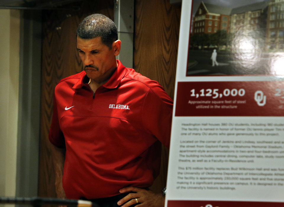 Photo - Co-offensive coordinator Jay Norvell waits to speak during media access day for the University of Oklahoma Sooner (OU) football team in the Adrian Peterson meeting room in Gaylord Family-Oklahoma Memorial Stadium in Norman, Okla., on Saturday, Aug. 3, 2013. Photo by Steve Sisney, The Oklahoman