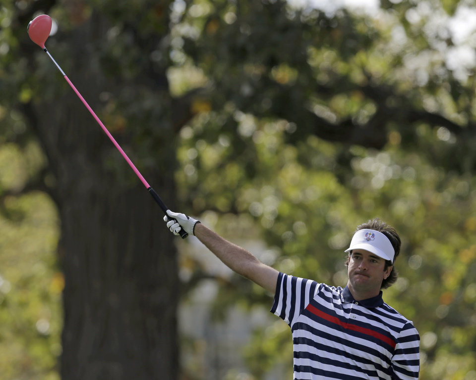 Photo - USA's Bubba Watson reacts to his tee shot on the fourth hole during a singles match at the Ryder Cup PGA golf tournament Sunday, Sept. 30, 2012, at the Medinah Country Club in Medinah, Ill. (AP Photo/David J. Phillip)  ORG XMIT: PGA118