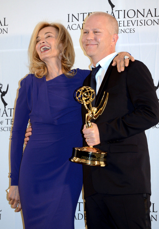 Photo -   Ryan Murphy, right, poses with presenter Jessica Lange after winning the Founders Award at the 40th International Emmy Awards, Monday, Nov. 19, 2012 in New York. (AP Photo/Henny Ray Abrams)