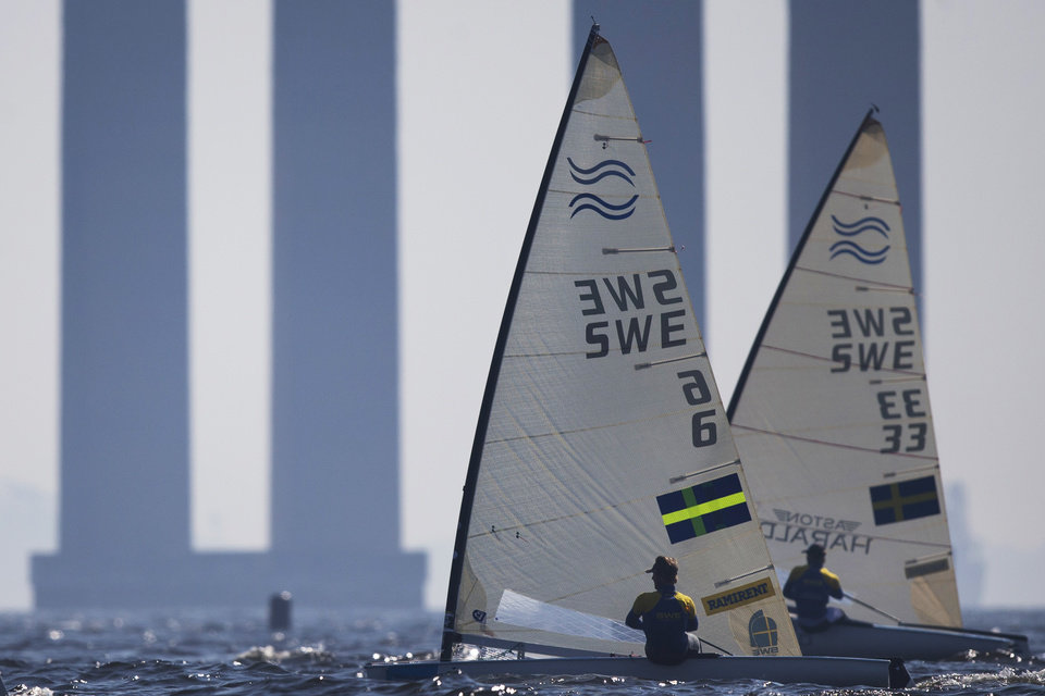 Photo - Sweden's Finn class Bjorn Allansson, left, and Max Salminen compete during the first test event for the Rio 2016 Olympic Games at the Guanabara Bay in Rio de Janeiro, Brazil, Sunday, Aug. 3, 2014. American sailing officials have hired medical experts to test the water in Guanabara, which has suffered from decades of untreated human waste being poured into the bay. (AP Photo/Felipe Dana)
