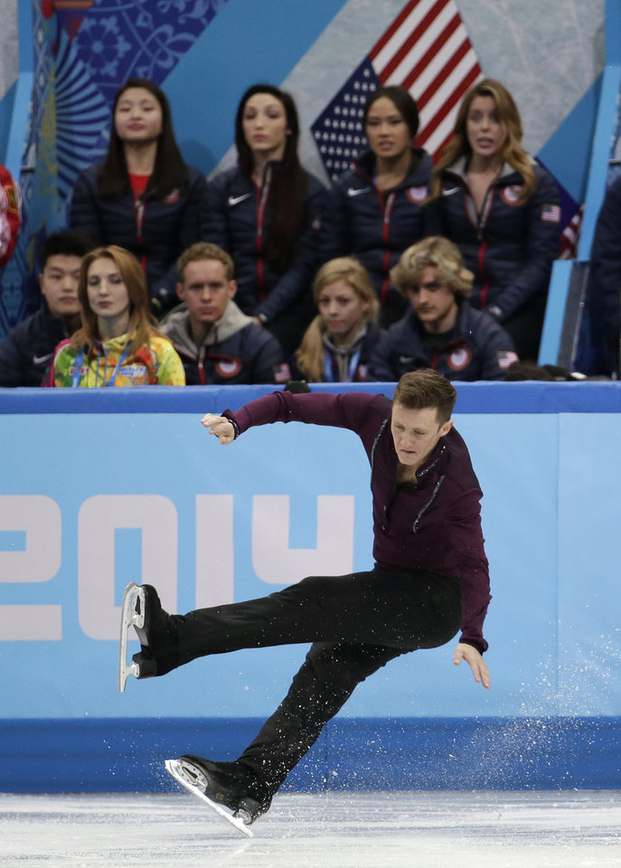 Photo - Jeremy Abbott of the United States falls as he competes in the men's team short program figure skating competition at the Iceberg Skating Palace during the 2014 Winter Olympics, Thursday, Feb. 6, 2014, in Sochi, Russia. (AP Photo/Bernat Armangue)