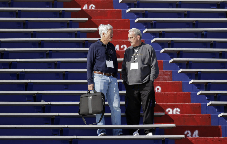 New Orleans Saints assistant head coach Joe Vitt, right, talks with radio announcer Greg Robinson during Senior Bowl football practice at Ladd-Peebles Stadium in Mobile, Ala., Tuesday, Jan. 22, 2013. Vitt served as head coach during the season long suspension of head coach Sean Payton. (AP Photo/Dave Martin)