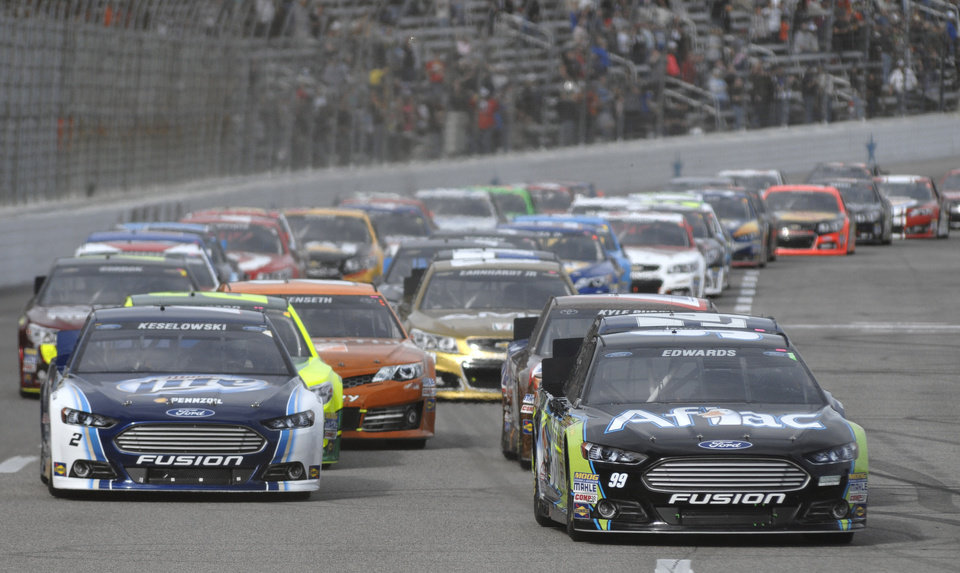 Photo - Carl Edwards (99), front right, leads the pack during the NASCAR Sprint Cup series auto race at Texas Motor Speedway in Fort Worth, Texas, Sunday, Nov. 3, 2013. (AP Photo/Ralph Lauer)