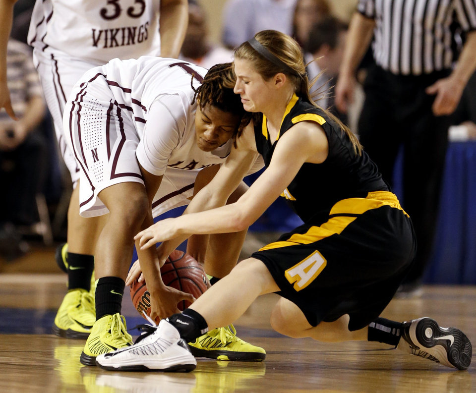 Northeast's Danielle Gaddis fights for possession with Alva's Bailey Forell during the 2A girls championship game between the Northeast Academy Lady Vikings and the Alva high school Lady Bugs at the State Fair Arena on Saturday, March 9, 2013 in Oklahoma City, Okla.  Photo by Steve Sisney, The Oklahoman