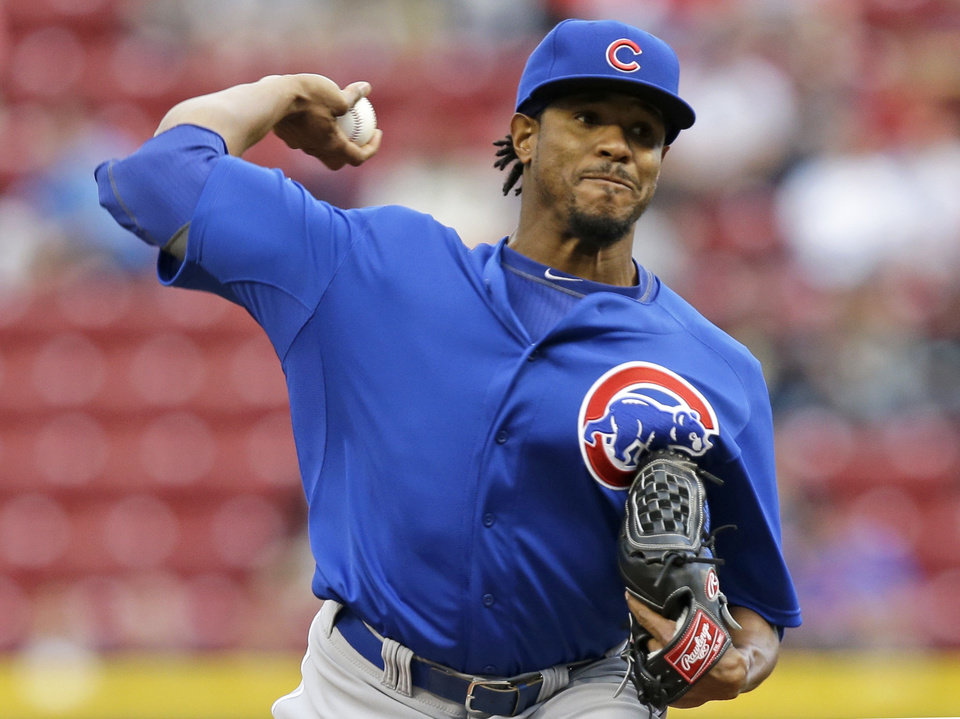 Photo - Chicago Cubs starting pitcher Edwin Jackson throws against the Cincinnati Reds in the first inning of a baseball game on Wednesday, April 30, 2014, in Cincinnati. (AP Photo)