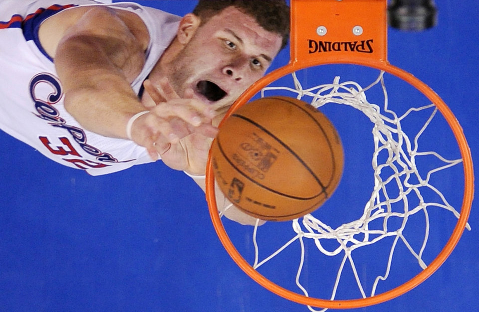 Photo - Los Angeles Clippers forward Blake Griffin puts up a shot during the first half of an NBA basketball game against the Houston Rockets, Wednesday, Dec. 22, 2010, in Los Angeles. (AP Photo/Mark J. Terrill)