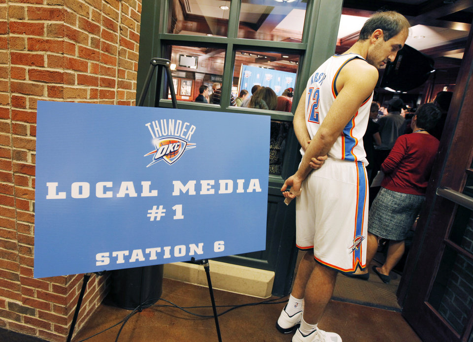 Oklahoma City center Nenad Krstic waits to give an interview during Thunder Media Day on Monday at the downtown arena. PHOTO BY NATE BILLINGS, THE OKLAHOMAN