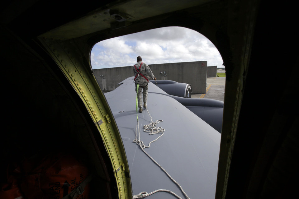In this Aug. 14, 2012 photo, ground crew member Staff Sgt. Jonathan Price, of Butler, PA, walks on the wing of a U.S. Air Force KC-135 Stratotanker, which was built in 1958, at Kadena Air Base on Japan's southwestern island of Okinawa. For decades, the U.S. Air Force has grown accustomed to such superlatives as unrivaled and unbeatable. Now some of its key aircraft are being described with terms like decrepit. (AP Photo/Greg Baker)