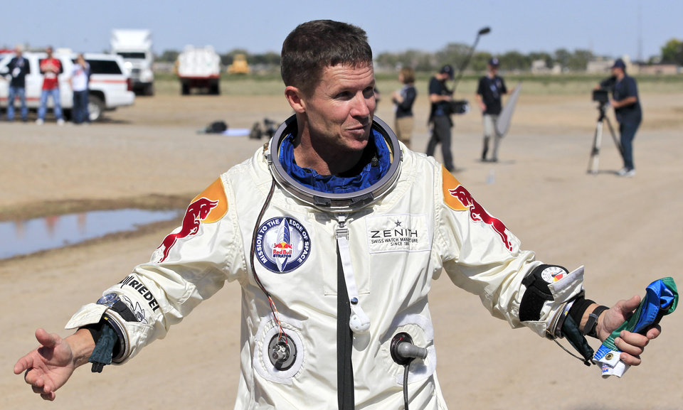 Felix Baumgartner, of Austria, gestures prior to speaking with the media after successfully jumping from a space capsule lifted by a helium balloon at a height of just over 128,000 feet above the Earth's surface, Sunday, Oct. 14, 2012, in Roswell, N.M. (AP Photo/Ross D. Franklin) ORG XMIT: NMRF129