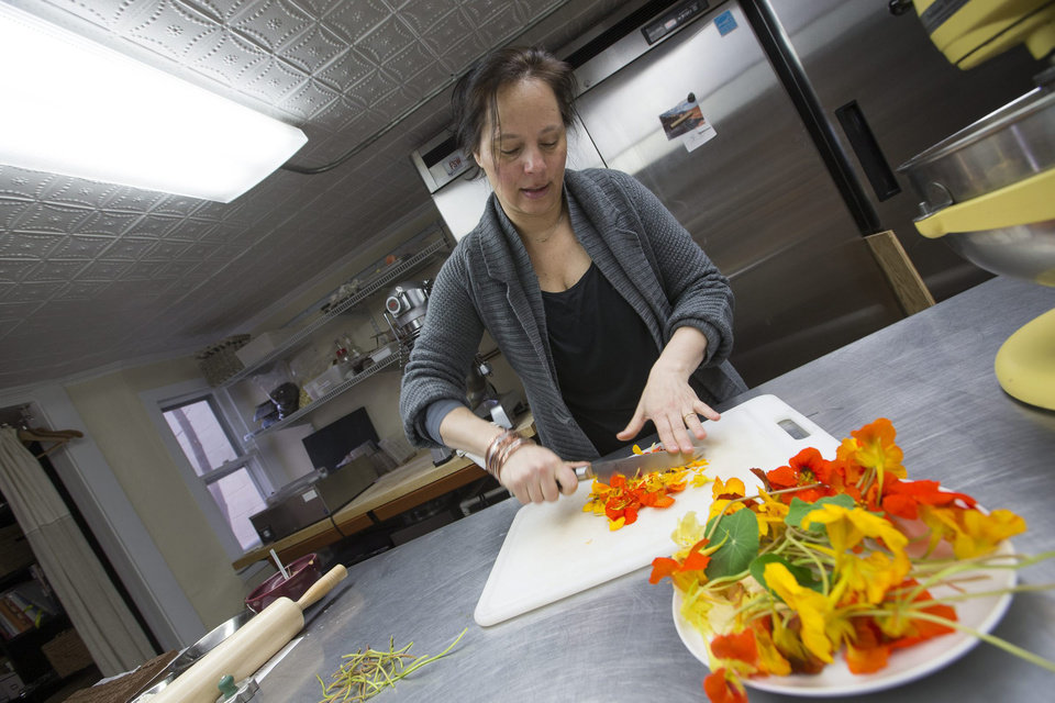 "Greenport chocolatier Miche Bacher, author of ""Cooking with Flowers,"" uses all natural ingredients in her chocolates, cookies and cakes in the Greenport studio. (Randee Daddona/Newsday/MCT)"