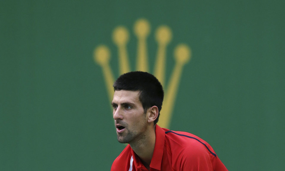 Photo -   Novak Djokovic of Serbia plays Grigor Dimitrov of Bulgaria in a second round men's singles match of the Shanghai Masters tennis tournament at Qizhong Forest Sports City Tennis Center in Shanghai, China, Wednesday Oct. 10, 2012. Djokovic won 6-3, 6-2. (AP Photo/Kin Cheung)