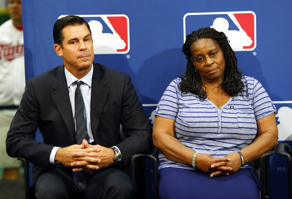 Photo - Former major league outfielder Billy Bean, left, and Lutha Burke look on during a news conference at baseball's All-Star game, Tuesday, July 15, 2014, in Minneapolis. Major League Baseball has appointed Bean, who came out as gay after his playing career, to serve as a consultant in guiding the sport toward greater inclusion and equality. Burke is the sister of Glenn Burke, who was the first MLB player to come out as gay after retiring. Burke died in 1995. (AP Photo/Paul Sancya)