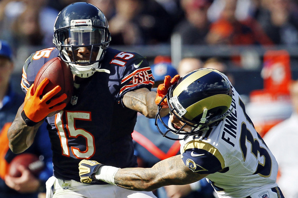 Photo -   Chicago Bears wide receiver Brandon Marshall (15) makes a catch against St. Louis Rams cornerback Cortland Finnegan (31) in the second half of an NFL football game in Chicago, Sunday, Sept. 23, 2012. The Bears won 23-6. (AP Photo/Charles Rex Arbogast)