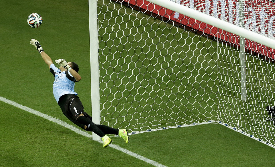 Photo - Costa Rica's goalkeeper Keylor Navas dives for a save during the World Cup quarterfinal soccer match between the Netherlands and Costa Rica at the Arena Fonte Nova in Salvador, Brazil, Saturday, July 5, 2014. (AP Photo/Themba Hadebe)