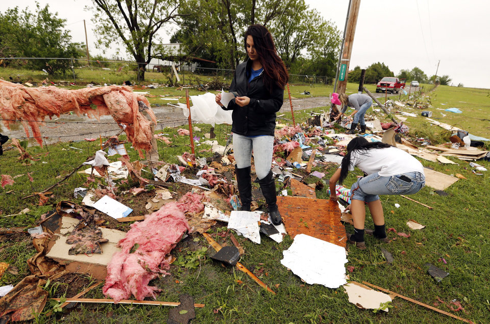 Photo - Courtney Aycox, daughter of Kris Allen looks for mementos and valuables in the wreckage of Kris and wife Christeen's mobil home--destroyed by storms--on Friday, April 29, 2016 in Ninnekah, Okla.  Photo by Steve Sisney, The Oklahoman