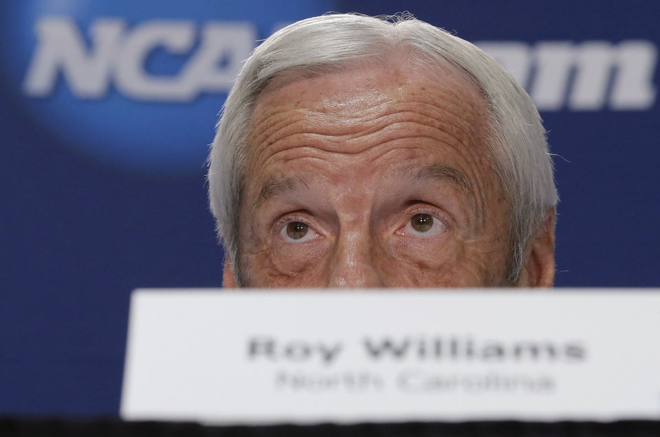 Photo - North Carolina coach Roy Williams peers over his nameplate during an NCAA college basketball tournament news conference, Saturday, March 22, 2014, in San Antonio. North Carolina will play Iowa State on Sunday. (AP Photo/Eric Gay)