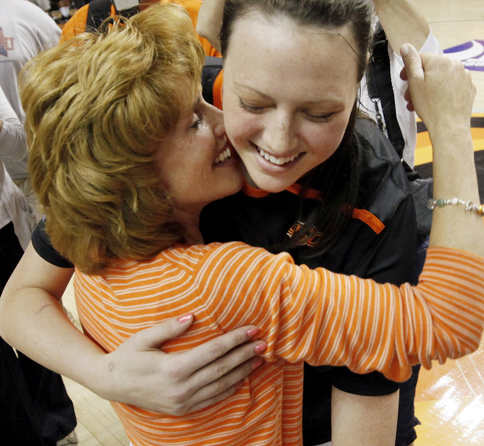 OSU's Vicky McIntyre (34) hugs Shelley Budke, widow of OSU head coach Kurt Budke, after the Women's NIT championship college basketball game between Oklahoma State University and James Madison at Gallagher-Iba Arena in Stillwater, Okla., Saturday, March 31, 2012. Kurt Budke and three others were killed in a plane crash on a recruiting trip in November of 2011. OSU won, 75-68. Photo by Nate Billings, The Oklahoman