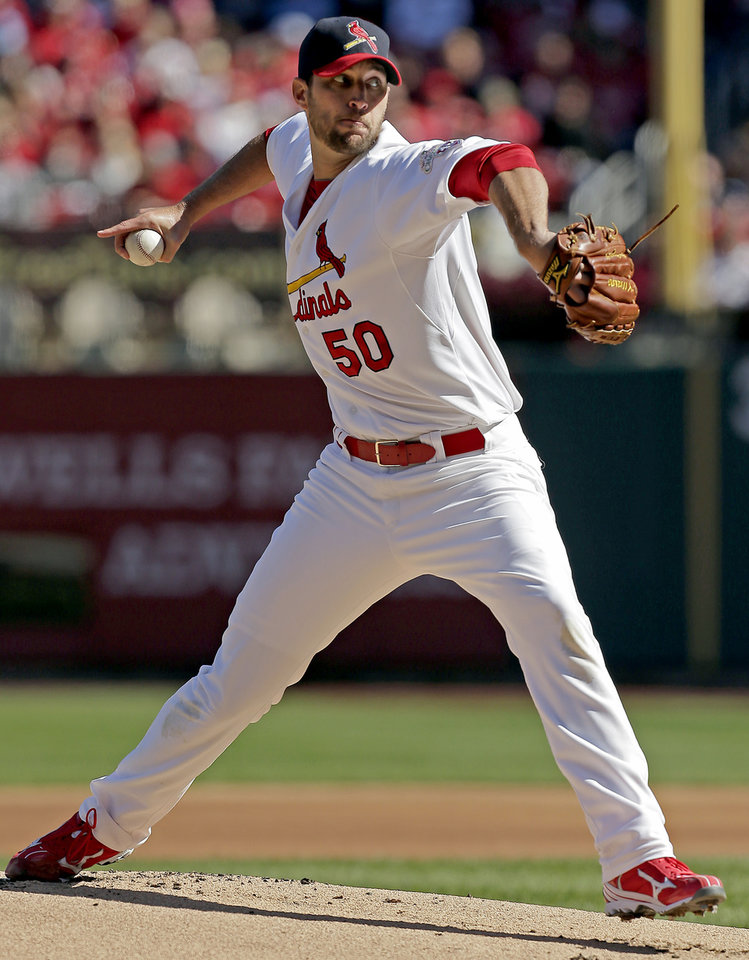 Photo -   St. Louis Cardinals starting pitcher Adam Wainwright throws during the first inning of Game 1 of the National League division baseball series against the Washington Nationals, Sunday, Oct. 7, 2012, in St. Louis. (AP Photo/Charlie Riedel)