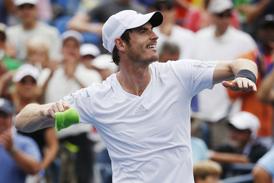 Photo - Andy Murray, of the United Kingdom,  throws his wrist band into the crowd after defeating Andrey Kuznetsov, of Russia, during the third round of the 2014 U.S. Open tennis tournament, Saturday, Aug. 30, 2014, in New York. (AP Photo/Kathy Willens)