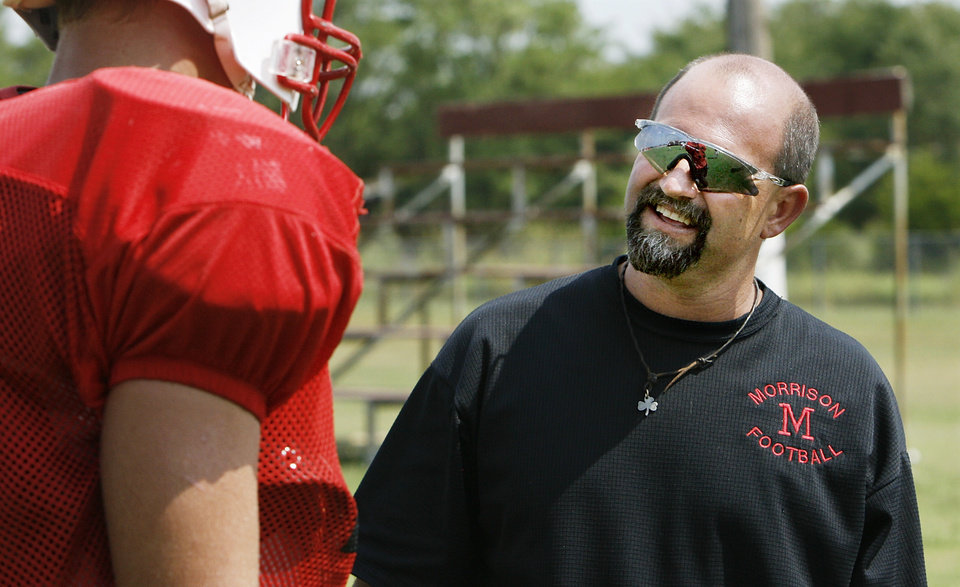 Photo - The Morrison Wildcats high school football team will make the change from 8-man to 11-man team as the school begins the season as a member of the Class A division for the first time. Head coach Cory Bales talks to a player during an afternoon practice.   Photo taken in Morrison on Wednesday,  Aug, 28, 2008.  BY JIM BECKEL, THE OKLAHOMAN ORG XMIT: KOD