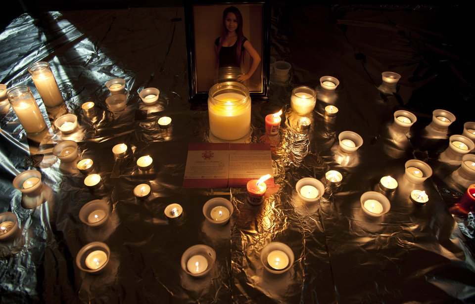 Photo - FILE - In this Friday, Oct. 19, 2012, file photo, candles are displayed in front of a picture of Amanda Todd during a memorial for her in Surrey, British Columbia. In Google's 12th annual roundup of global trending searches,