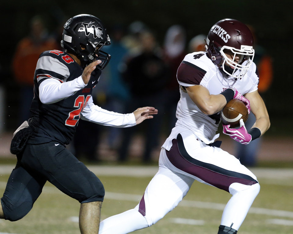 Jenks' Dylan Harding catches a pass in front of Westmoore's Lexus Lee in high school football on Friday, Oct. 18, 2013 in Moore, Okla.  Photo by Steve Sisney, The Oklahoman