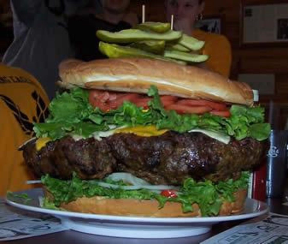 Photo - GIANT HAMBURGER: The Belly Buster burger from Denny's Beer Barrel Pub in Pennsylvania. The beef patty is 15 pounds, the same amount of weight I've lost so far.      ORG XMIT: 1005080027183758