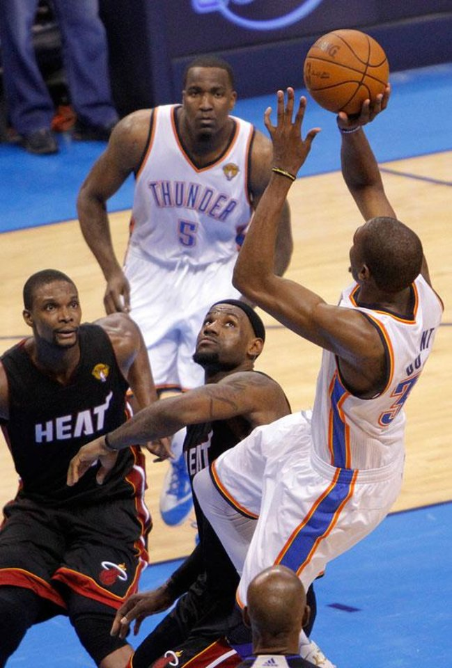 Photo -  Oklahoma City's Kevin Durant (35) puts up the last shot over Miami's LeBron James (6) and Chris Bosh (1) during Game 2 of the NBA Finals between the Oklahoma City Thunder and the Miami Heat at Chesapeake Energy Arena in Oklahoma City, Thursday, June 14, 2012. Photo by Chris Landsberger, The Oklahoman