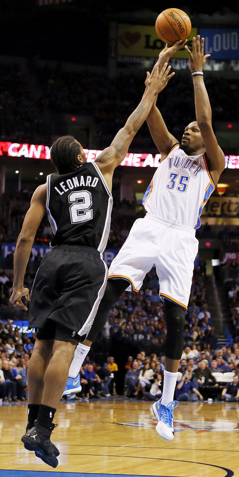 Oklahoma City's Kevin Durant (35) shoots over San Antonio's Kawhi Leonard (2) during an NBA basketball game between the Oklahoma City Thunder and the San Antonio Spurs at Chesapeake Energy Arena in Oklahoma City, Wednesday, Nov. 27, 2013. Oklahoma City won, 94-88. Photo by Nate Billings, The Oklahoman