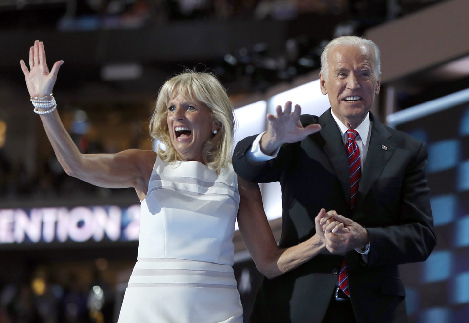 Photo - Dr. Jill Biden and Vice President Joe Biden wave after speaking to delegates during the third day session of the Democratic National Convention in Philadelphia, Wednesday, July 27, 2016. (AP Photo/Carolyn Kaster)