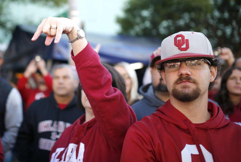 Photo - A fan does the Horns Down as Texas players arrive before the Red River Showdown college football game between the University of Oklahoma Sooners (OU) and the Texas Longhorns (UT) at Cotton Bowl Stadium in Dallas, Saturday, Oct. 12, 2019. [Sarah Phipps/The Oklahoman]