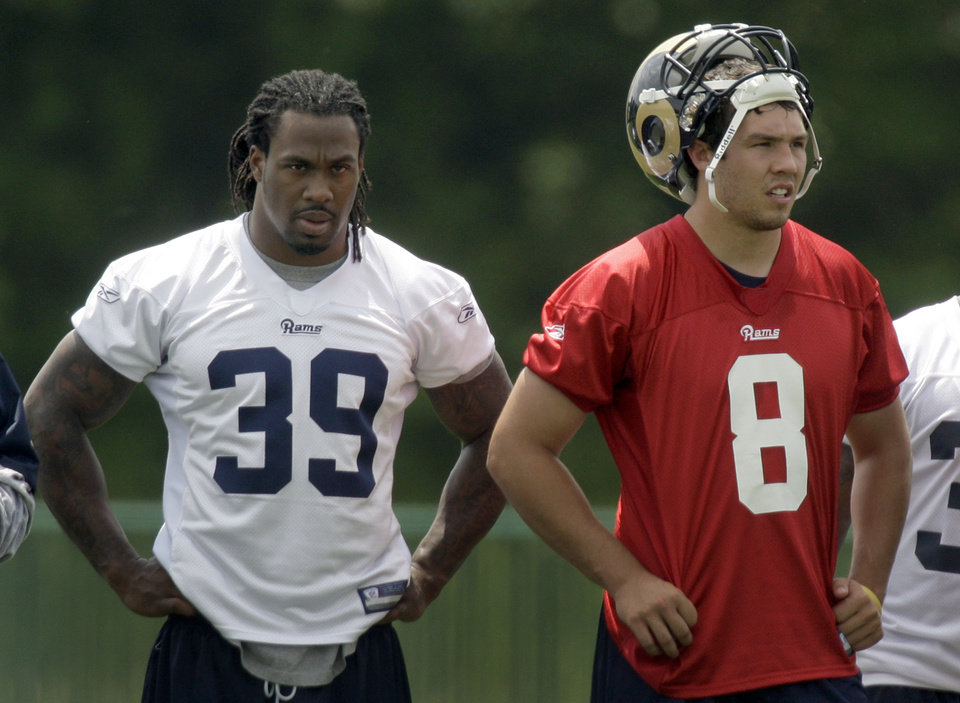 Photo - St. Louis Rams running back Steven Jackson, left, and quarterback Sam Bradford watch drills during NFL football organized team activities at the Rams' training facility Monday, May 24, 2010, at the Rams' training facility in St. Louis. (AP Photo/Jeff Roberson) ORG XMIT: MOJR107
