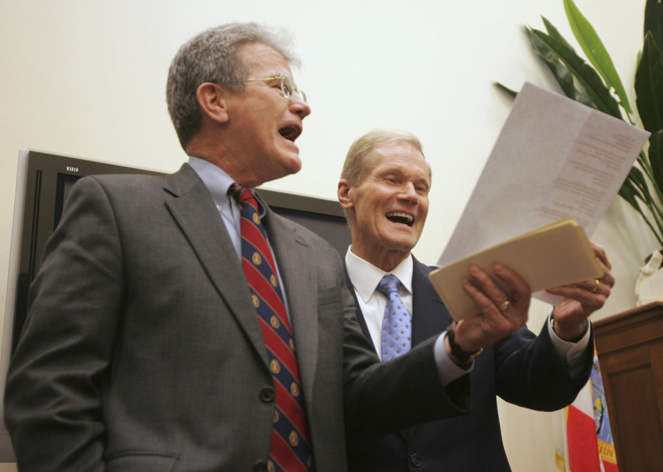 Photo - Sen. Tom Coburn, R-Okla., left, sings Elton John's