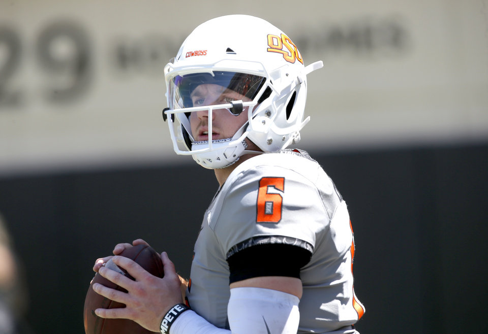 Photo - Oklahoma State's Dru Brown (6) throws during drills during the Oklahoma State Cowboys spring practice at Boone Pickens Stadium in Stillwater, Okla., Saturday, April 20, 2019.  Photo by Sarah Phipps, The Oklahoman