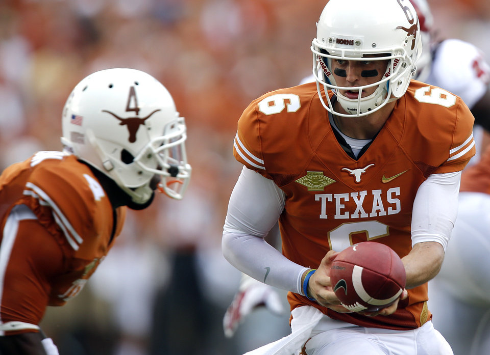 UT's Case McCoy (6) hands the ball off to Daje Johnson (4) during the Red River Rivalry college football game between the University of Oklahoma Sooners (OU) and the University of Texas Longhorns (UT) at the Cotton Bowl Stadium in Dallas, Saturday, Oct. 12, 2013. Photo by Chris Landsberger, The Oklahoman