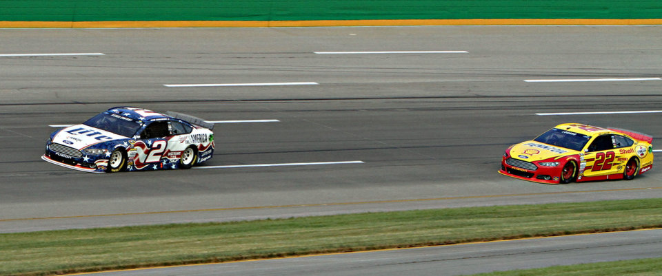 Photo - Pole-sitter Brad Keselowski (2) leads Joey Logano (22) during the NASCAR Sprint Cup series auto race Saturday, June 28, 2014, at Kentucky Speedway in Sparta, Ky. (AP Photo/Garry Jones)