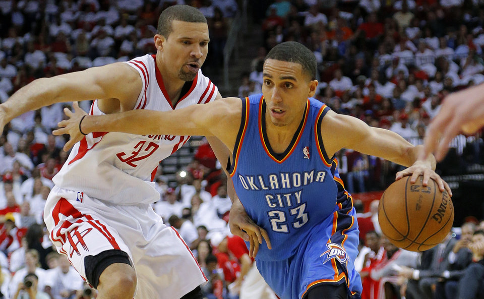 Photo - NBA BASKETBALL: Oklahoma City's Kevin Martin (23) goes past Houston's Francisco Garcia (32) during Game 3 in the first round of the NBA playoffs between the Oklahoma City Thunder and the Houston Rockets at the Toyota Center in Houston, Texas, Sat., April 27, 2013. Oklahoma City won 104-101. Photo by Bryan Terry, The Oklahoman