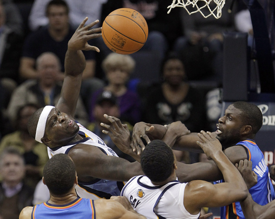 Memphis Grizzlies\' Zach Randolph, top, and Rudy Gay fight for a rebound against Oklahoma City Thunder\'s Thabo Sefolosha, left, of Switzerland, and Nazr Mohammed, right, in the first half of an NBA basketball game Wednesday, Dec. 28, 2011, in Memphis, Tenn. (AP Photo/Lance Murphey) ORG XMIT: TNLM103