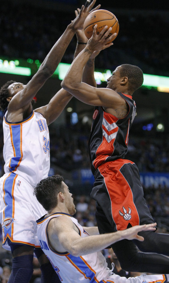 Photo -   Toronto Raptors guard DeMar DeRozan (10) looks for a shot against Oklahoma City Thunder center Hasheem Thabeet, left, as Thunder forward Nick Collison falls to the floor in the first quarter of an NBA basketball game in Oklahoma City, Tuesday, Nov. 6, 2012. (AP Photo/Alonzo Adams)