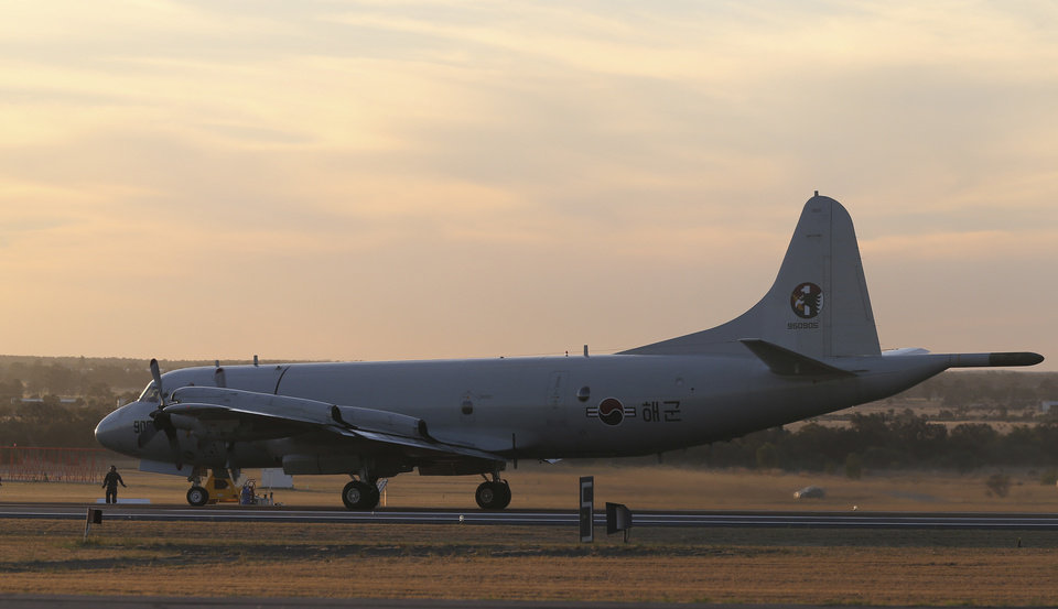 Photo - A South Korean Navy P-3 Orion sits on the runway after returning from a search operation for the missing Malaysia Airlines Flight MH370, at Royal Australian Air Force base Peace in Perth, Australia, Thursday, April 3, 2014. The search operation continues but no trace of the Boeing 777 has been found nearly a month after it vanished in the early hours of March 8 on a flight from Kuala Lumpur to Beijing with 239 people on board. (AP Photo/Rob Griffith, Pool)