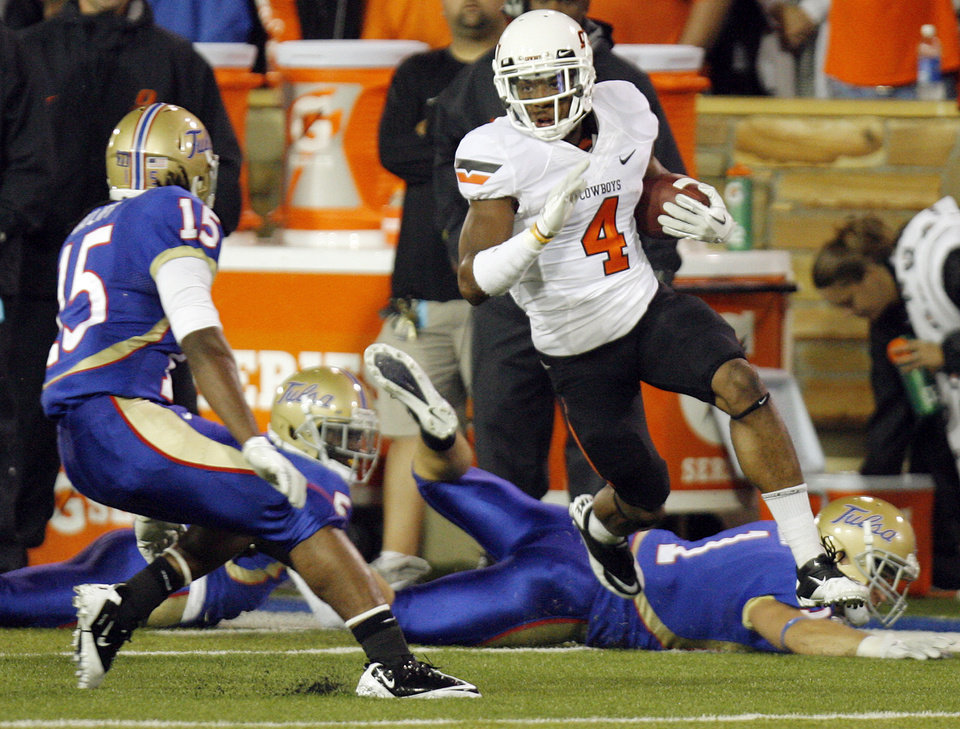 Photo - OSU's Justin Gilbert (4) leaves behind TU defenders before getting past J.D. Ratliff (15) on his way to a kickoff return for a touchdown in the first quarter during a college football game between the Oklahoma State University Cowboys  and the University of Tulsa Golden Hurricane at H.A. Chapman Stadium in Tulsa, Okla., Sunday morning, Sept. 18, 2011. Photo by Nate Billings, The Oklahoman