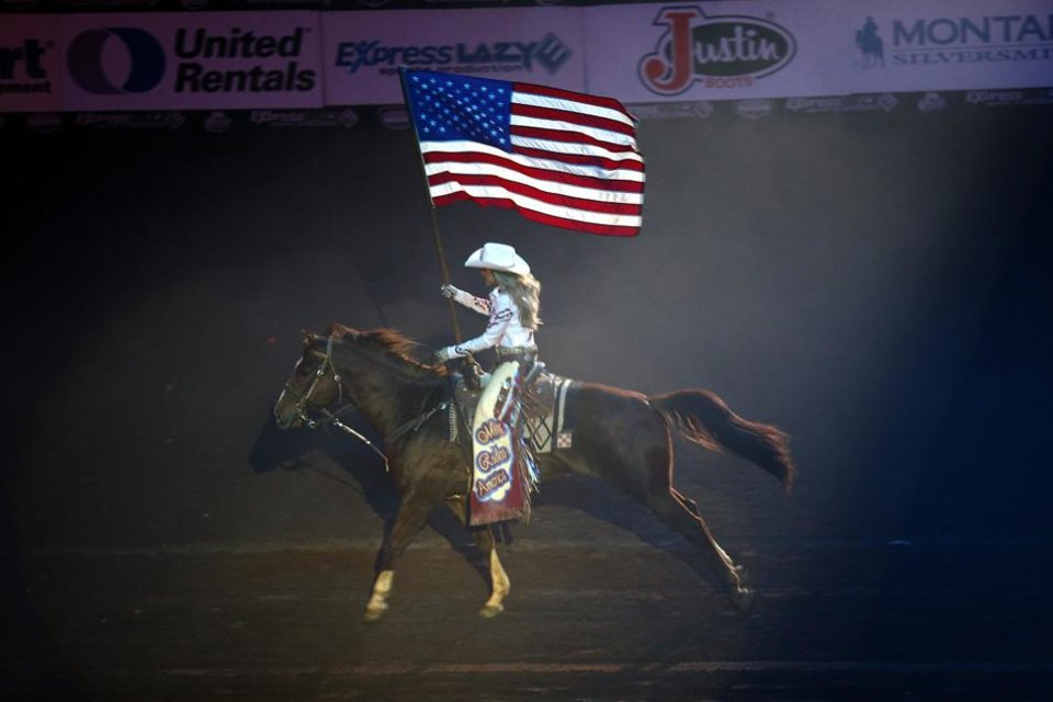 The American flag is presented the National Circuit Finals Rodeo at the State Fair Arena in Oklahoma City, Friday, April 5, 2013. Photo by Sarah Phipps, The Oklahoman