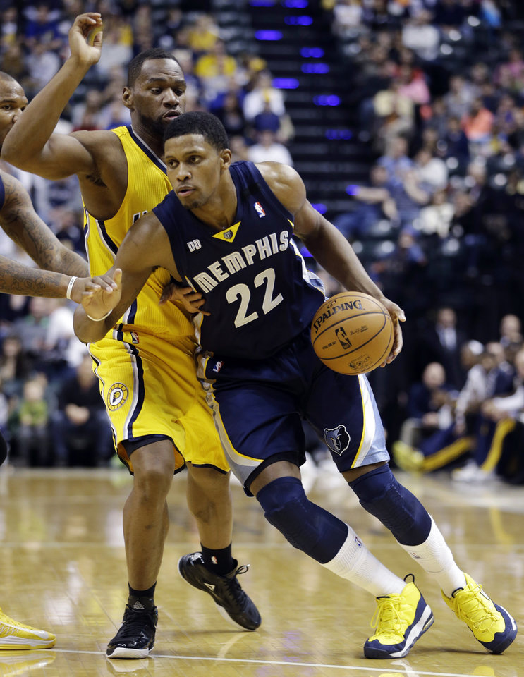 Memphis Grizzlies' Rudy Gay (22) goes to the basket against Indiana Pacers' Lance Stephenson (1) during the first half of an NBA basketball game, Monday, Dec. 31, 2012, in Indianapolis. (AP Photo/Darron Cummings)