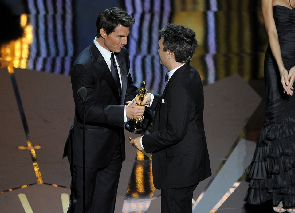 "Thomas Langmann, right, accepts the Oscar for best picture for ""The Artist,"" presented by Tom Cruise, during the 84th Academy Awards on Sunday, Feb. 26, 2012, in the Hollywood section of Los Angeles. (AP Photo/Mark J. Terrill) ORG XMIT: SHO331"
