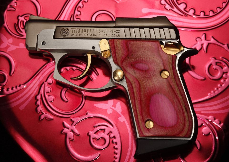 Photo - A pink Taurus PT-22 pistol at Big Boy's Guns and Ammo in Oklahoma City.  Steve Gooch - The Oklahoman
